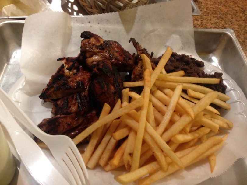 Roasted chicken, french fries, and black beans